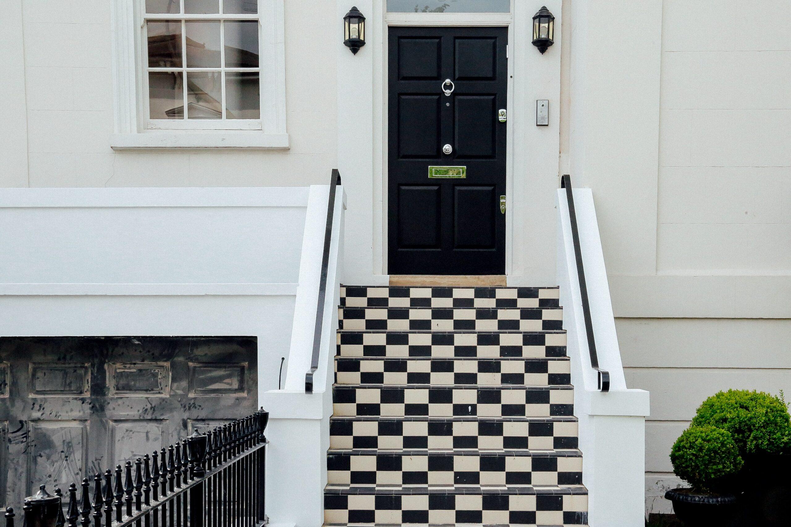 White house, black door, black and white steps