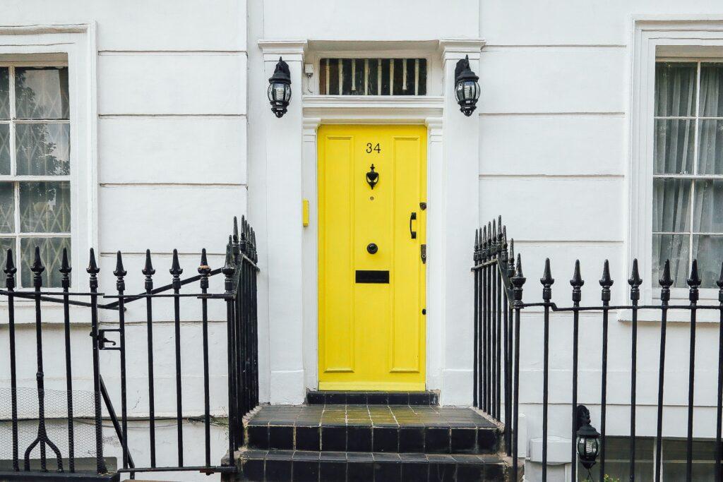 Yellow door, black tile path