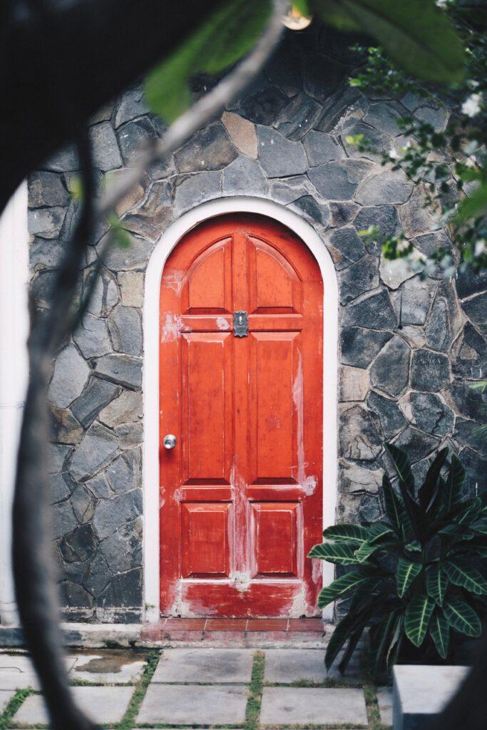 Red door, stone house, stone path