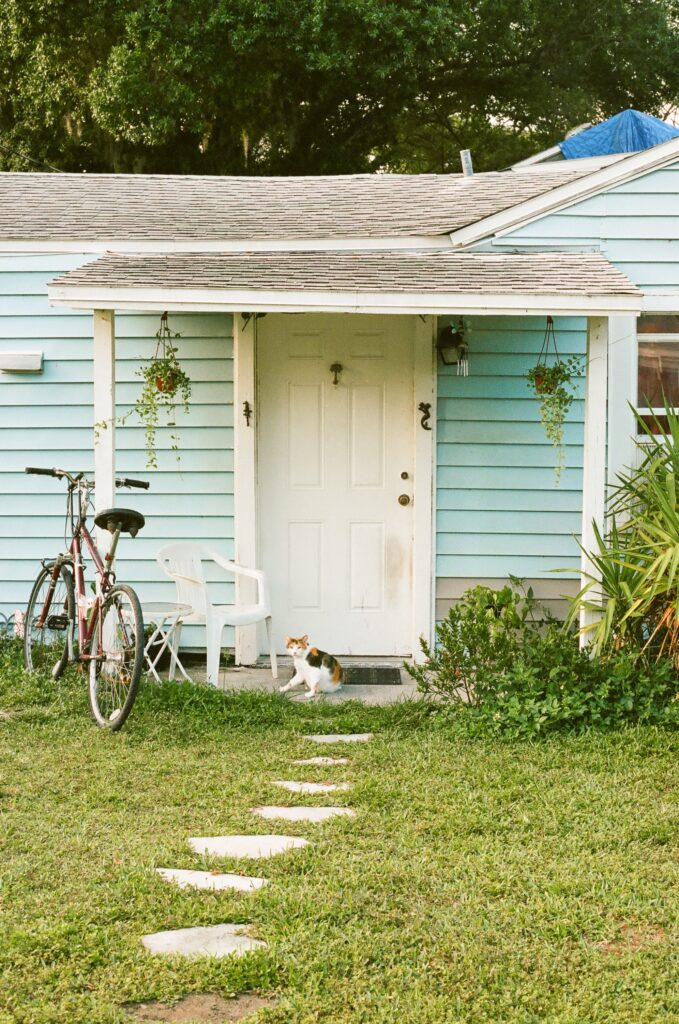 Blue house paver front path bike